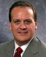 Mark E. Cooper, MD